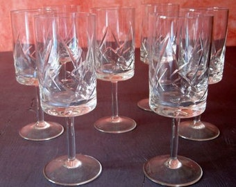 7 flutes has sparkling cut glass. Vintage France french object.  Aperitif glasses design. Table art. Glass. Mulled wine