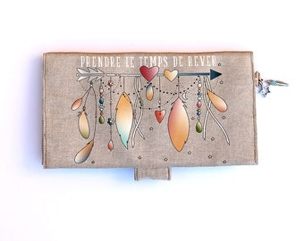 "Checkbook covers in natural linen featuring ""Take time to dream"""