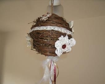 ball made of twigs, butterflies and lace flowers