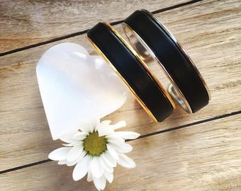 Bangle featuring a black leather thong