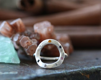 For Eternity hand forged sterling silver ring with flush set gem stones