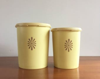 Tupperware set of 2 yellow containers with lids in relief
