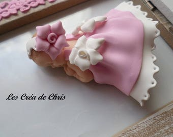 baby girl's christening gown with fimo flower.