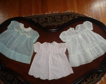 Charming collection of vintage baby girl dresses