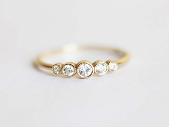 sidestones and engagement with rings classic round diamond baguette setting five ring stone