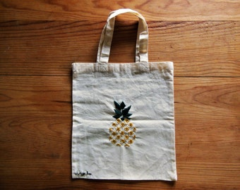 Embroidered pineapple on small totebag