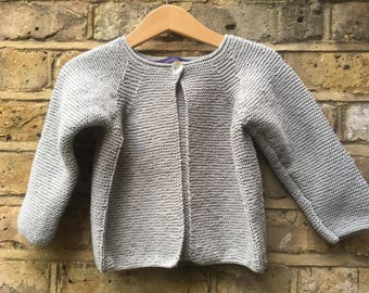 Grey cardigan for a little girl.