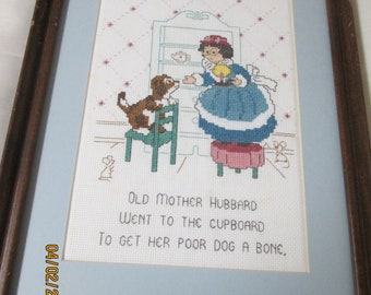 Old Mother Hubbard Cross Stitch-Finished and Framed-11x13 with Blue Mat and Brown Frame-Professionally framed