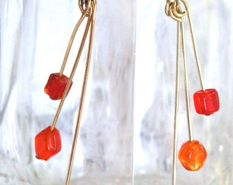 Orange dangle glass bead earrings