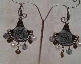bronze earrings and gray flower