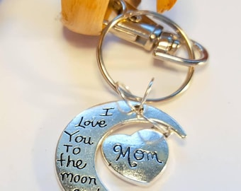 I love you to the moon and back mom and granddaughter charm,half moon silver,with silver heart mom silver keyring, keychain.