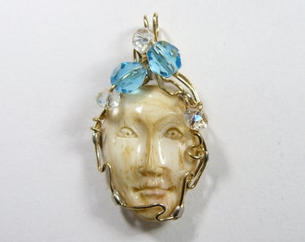 Carved Moon Face Wire Wrapped Pendant using 14kgf wire, carved ox bone (w071)