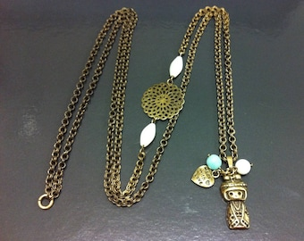 Bronze brass necklace with kokeshi doll, mother of Pearl and amazonite