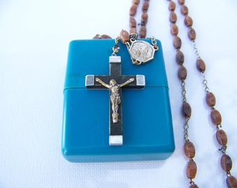 Religious rosary bead plastic crucifix metal and wood appearance of the Virgin to Bernadette Medal