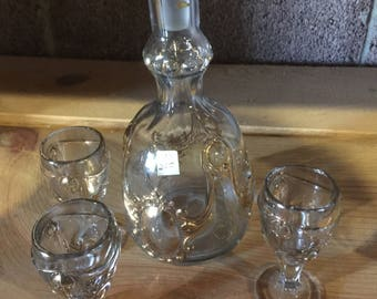 Vintage brandy containter with shot glasses