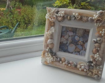 Wooden photo frame with sea shells, razor clam shells, starfish and pearl decorations, seashell picture frame