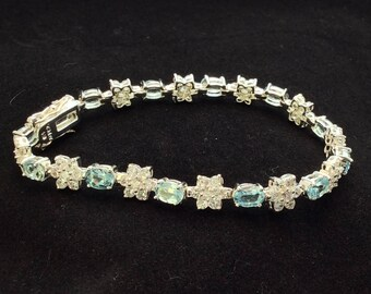 Sterling Silver Blue Topaz and Cubic Zirconia Flower Tennis Bracelet, Ladies Blue Flower Bracelet