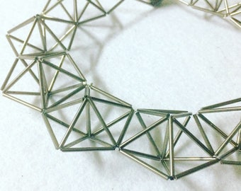 Three dimensional pentagons necklace in glass tubes