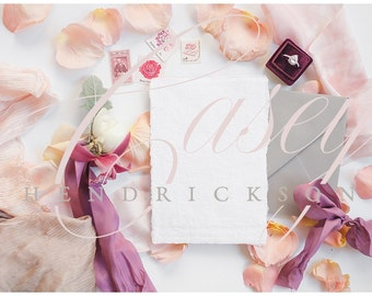 Deckled edge orchid and pink wedding invitation mockup stock photo
