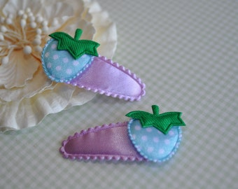 Blue Strawberry on purple padded clip