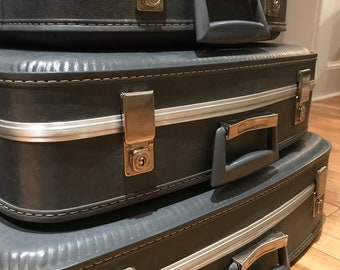 Four-Piece Nested Set of Vintage Luggage