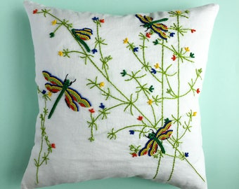 Dragonflies & Waterplantains cushion, green, orange, yellow and blue on white linen