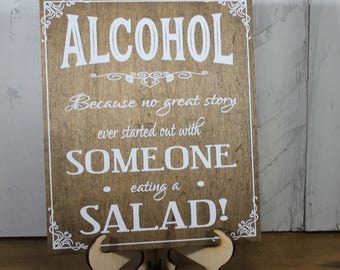 Alcohol/Because no good story/Someone eating a Salad/Wood Sign/Reception Sign/Bar Sign