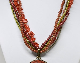 Stunning red tone beaded necklace