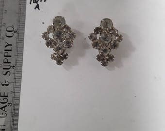 Silver toned rhinestone shoe clips used