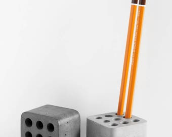 Concrete organizer for storage of writing instruments