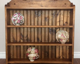 Rose carved, 12 cup, tea cup collectors shelf