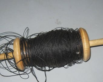 Vintage wooden fishing reel with line