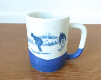 Matte blue and white snow skier mug in excellent condition