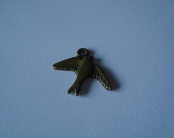 Antique gold bird charm