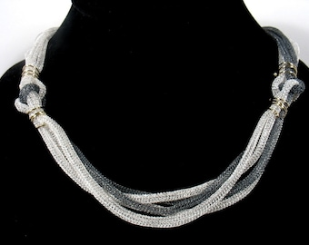 Silver and gold mesh necklace-Challenging Gravity - mesh silver chain with gold elements.