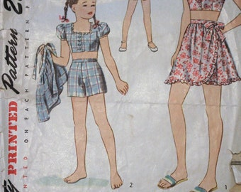 1947 Simplicity sewing pattern #2121 - Girls' three piece play suit; Shorts, wrap-around skirt and bare midriff blouse, Size 12; Complete
