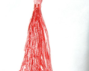 Coral cotton tassel twisted 12 cm x 1.5 cm.