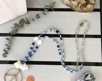 Ripple necklace with gold peace sign, druzy crystals, and glass beads