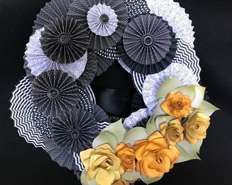 Black and white paper rosette wreath with hand inked yellow roses