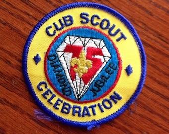 "Vintage 1985 ""Cub Scout Celebration"" patch for the Diamond Jubilee-75th Anniversary of Boy Scouts of America. Round and measures approximate"