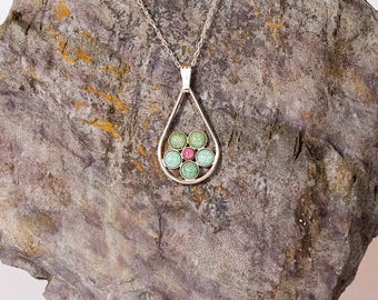 A handmade, sterling silver, teardrop pendant. With green and pink kiln fired enamels. With a FREE chain and FREE UK postage.