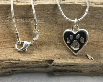 Necklace. SIlver snack chain necklace with silver and black paw print heart charm