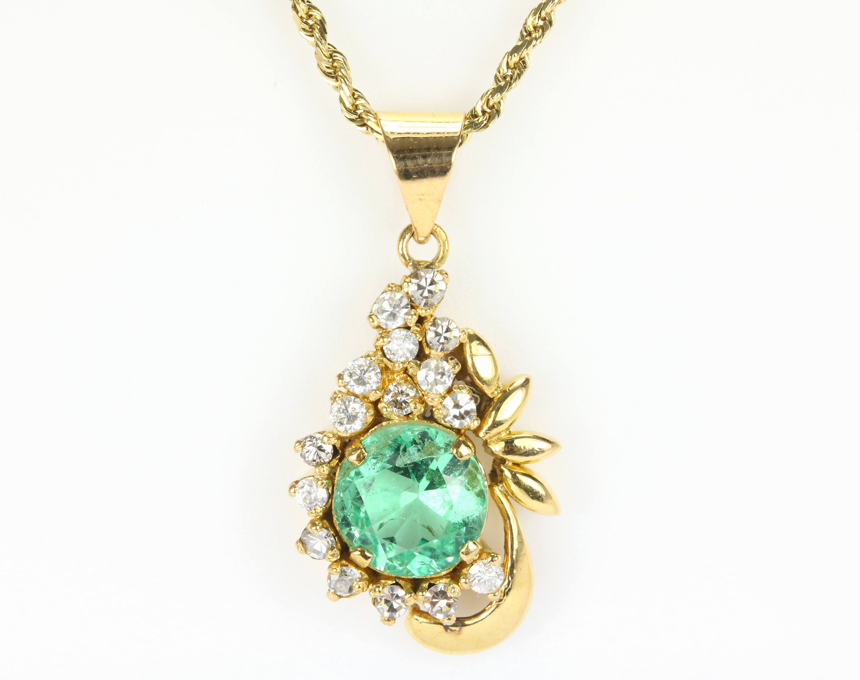 accented heart are by pin that necklace stone pendant genuine this showcases diamonds a emerald shaped