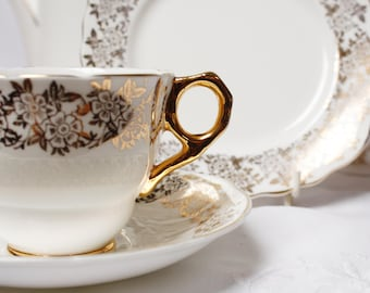 """Gold and white teaset: exquisite English """"Lucerne"""" gold and white bone china tea cup, saucer and tea plate, perfect for afternoon tea"""