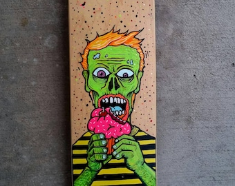 """Zombie Eating Cupcake Skateboard Deck; Great Gift for your skater! Hand painted, bright colors, 31.85""""x 7.52"""". Spooky, Scary, Undead, Brains"""