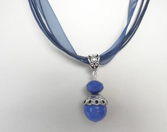 Necklace pendant blue beads on laces and Blue Ribbon