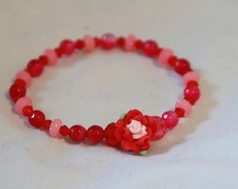 Red and pink flowered bracelet.