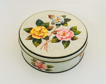 A Large Vintage Flower Tin.