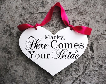 Here Comes Your Bride with Grooms Name with And they lived Happily on reverse side. 11 1/2 X 14 1/2 inches, 2-Sided.  Wooden Heart Sign.