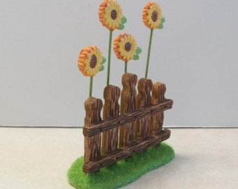 Miniature fence with grass and sunflowers for Fairy garden or terrariums